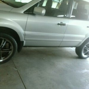 "20"" Zinik rims with Pirelli Low Profile tires."